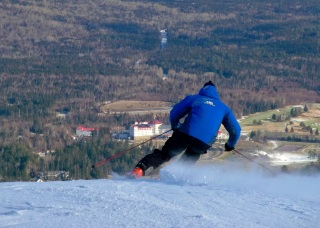Bretton Woods Ski Team Coach, Sven Swanson, setting a nice edge near the summit........if there's not much snow in your backyard, we've got plenty on our slopes and we're adding tons more each day so be our guest, come join Sven, and carve away!
