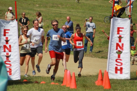 A group of runners cross the finish line at last year's inaugural Thad Thorne 5k Memorial Race. The race is named for one of the founding fathers of Attitash and proceeds from the event registration benefit the Bartlett Middle School Ski Team.