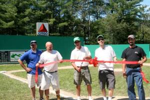 The Seasons Resort on Attitash Rd. in Bartlett celebrated the grand opening of The Seasons' Fenway Park Jr. with a ribbon cutting on Sunday. The Seasons' Fenway Park Jr. features a replica of Fenway Park itself that has been tailor-made for wiffle ball. Pictured left to right during the ribbon cutting ceremony are: Joey Miller, Account Developer at The Believe in Books Foundation; Bob Merchant; Erik Atwell, Marketing Director of The Seasons Resort; Bryan Stovall, General Manager of The Seasons Resort; and Bryon Gil. The First Annual Home Runs for Literacy, A Home Run Derby fundraiser for Believe in Books Literacy Foundation followed the ribbon cutting, raising over $850 for Believe in Books.