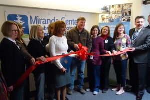 Leavitt Family and Memorial Hospital Staff cutting the ribbon at the grand opening of the Miranda Center for Diabetes & Endocrinology at Memorial Hospital