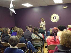 Olivia Ducasse presenting a holistic life seminar