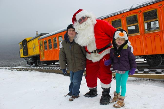 Santa Rides up Mount Washington on the Cog Railway Snow Train